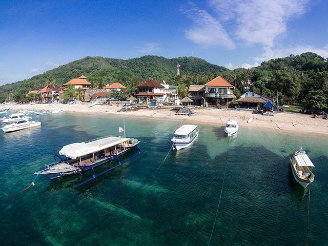 Aerial Drone Photography Bali Padang Bai Bay Beachfront Harbour Geko Dive Diveshop Boats 640px